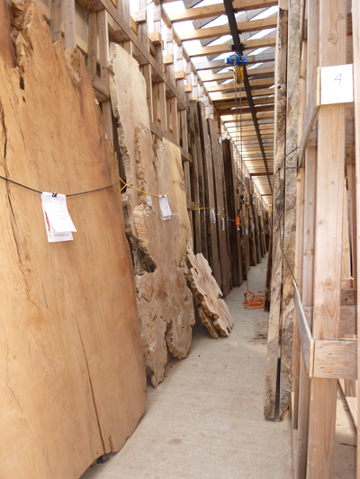 One of our many aisles of vertically stacked wood slabs